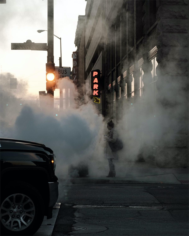 Person standing on hazy street corner