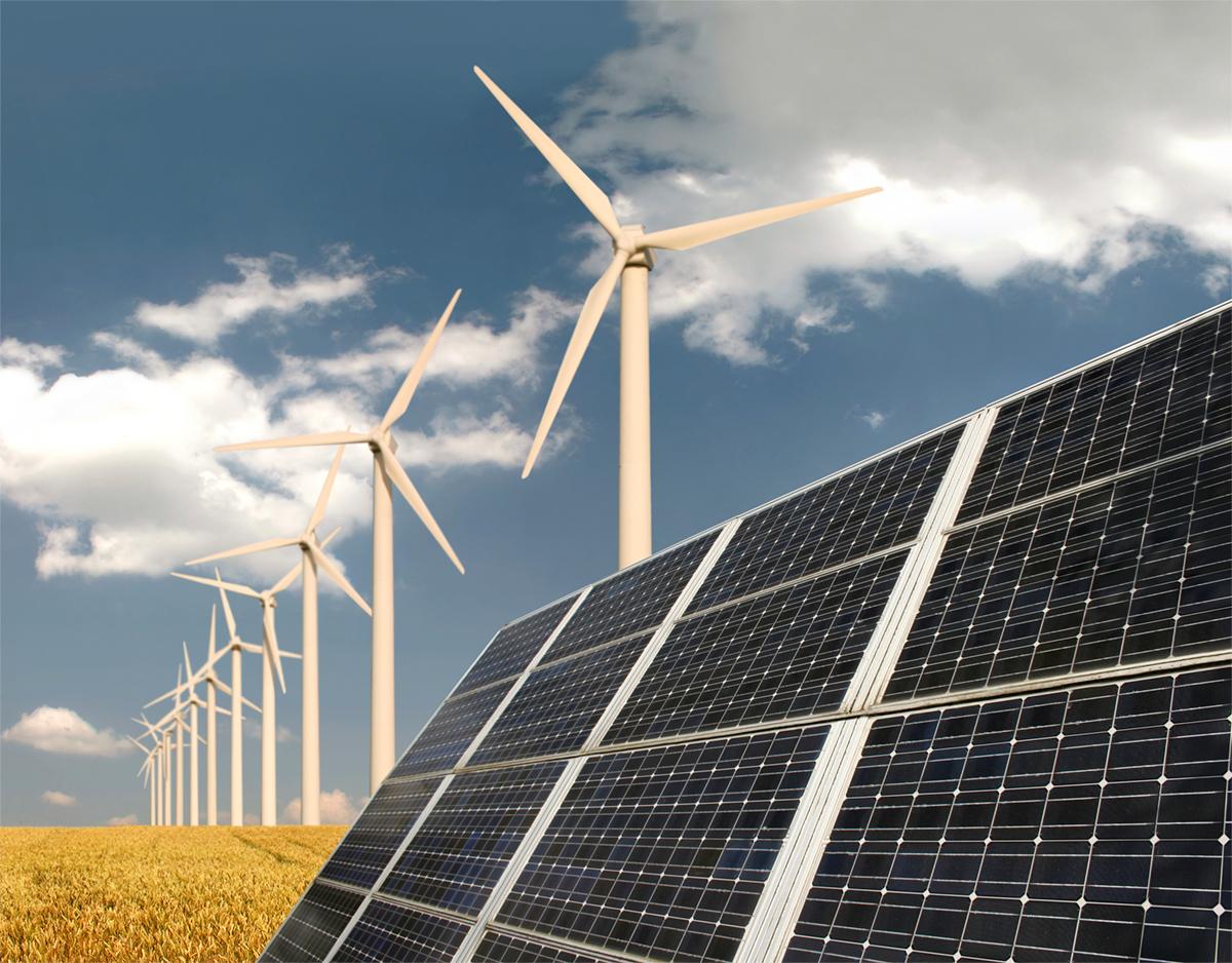 Solar panels and wind mills near prairie
